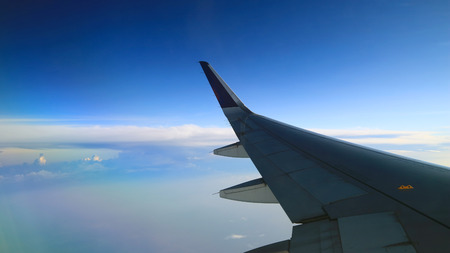 peaceful morning cloudy blue sky view from commercial airplane windows Standard-Bild - 117691337