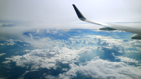 cloudy blue sky view from commercial airplane windows Standard-Bild