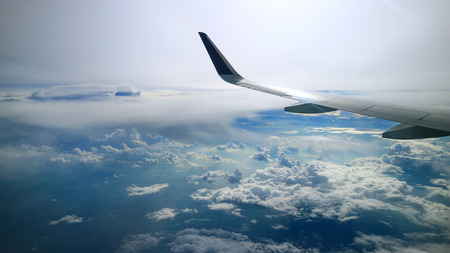 morning cloudy blue sky view from commercial airplane windows Standard-Bild