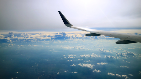 dramatic cloudy sky view from commercial airplane windows Standard-Bild