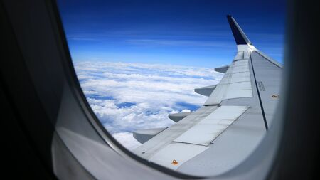 beautiful blue sky view from commercial airplane windows