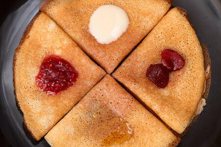 sour cream: Pancakes with strawberry jam, raspberry jam, sour cream and honey