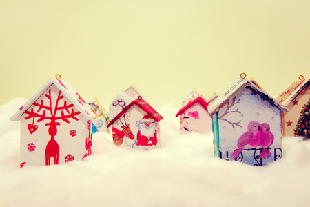 Fir tree decoration: handmade houses with Christmas ornaments in wool simulating snow Stock Photo