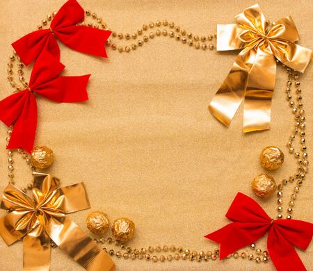 New year and Christmas background of gold paper and decorations with space for your text