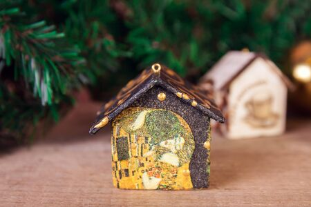 Fir tree decoration: handmade Christmas and New Year houses with ornaments
