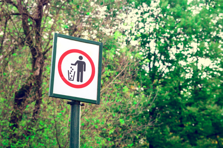 Prohibiting  littering sign in forest. Environmental pollution concept