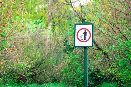 Prohibiting  littering sign in forest. Environmental protection concept Stock Photo