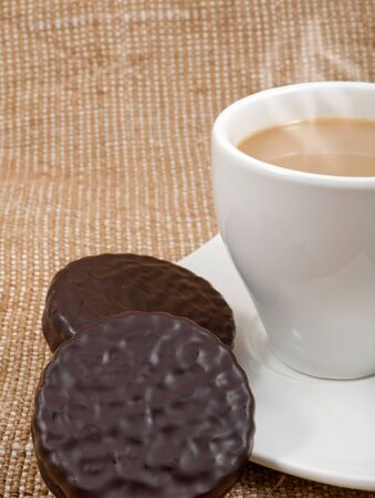 coffee and milk  and chocolate biscuits on a background sacking photo