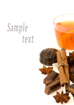 tea, chocolate, cinnamon, anise  on  a white background photo