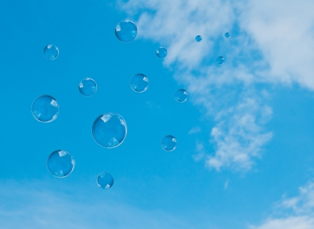 soap-bubbles on a background blue sky photo