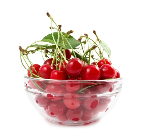 cherry with handles in a transparent bowl photo