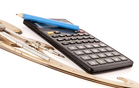 calculator, крандаш, line and compasses on a white background photo