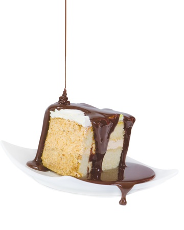 the drop of chocolate flowing down from a saucer with the piece of cake Stock Photo