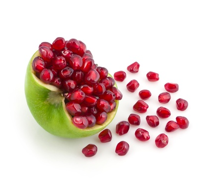 grains of pomegranate are in an apple photo