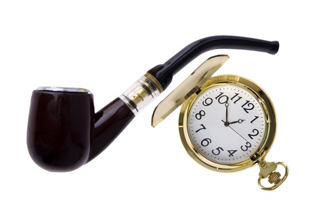 clock is round, ancient, gold with a lid and smoking tube on a white background photo