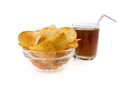 aliments: chips in a dish on a background glass with drink isolated