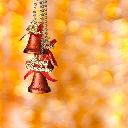 red Christmas bells on the yellow soft background photo