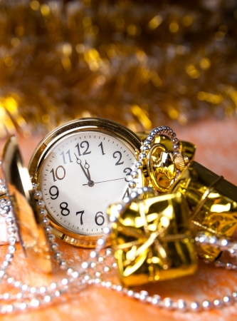 round, pocket watches are among the gifts,Christmas beads on the yellow photo