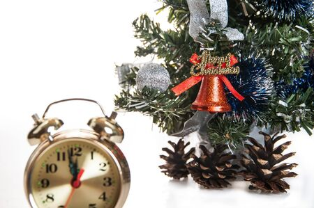 clock,bumps on the background of a decorated Christmas tree in the white photo