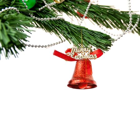 Christmas bell and new year beads on the branch of a tree on a white background photo