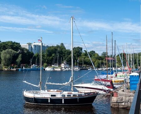 the yachts moored in the port on the quay photo