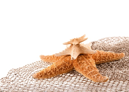 fishingnet: three sea the stars of different sizes lie on each other on the fishing net Stock Photo
