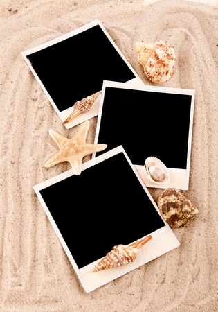three cards with shells on the sand photo