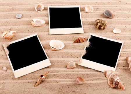 background of the three cards on the sand with shells photo