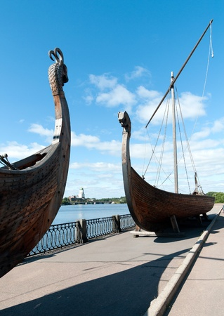two old Drakkar boats of the Vikings on the embankment of the Vyborg photo