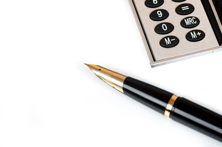 fountain pen and calculator on a white background photo