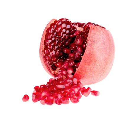 out of context: fruit pomegranate seed poured out of the fetus in the context of on a white background