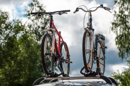 two bikes on the trunk of the car Stock Photo