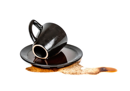 spilled coffee in inverted black Cup with a saucer isolated Stock Photo
