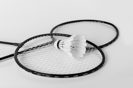 racket and shuttlecock isolate on white background photo
