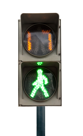 green signal of a traffic light in isolation photo
