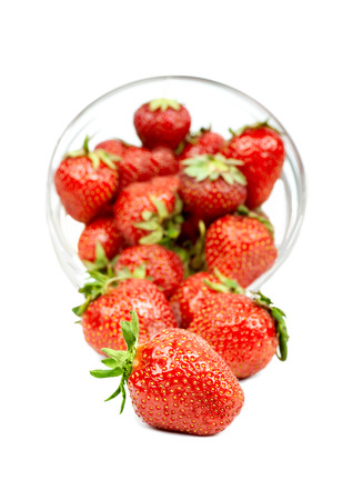 trickling: Strawberry trickling through the transparent plate isolated Stock Photo