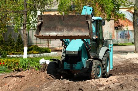 sandpit: Wheel loader Excavator with back hoe loading sand
