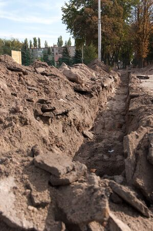 trenching: dug a ditch at the construction site Stock Photo