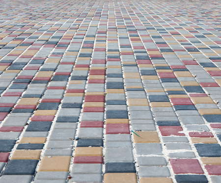 extending: colour paving slabs extending to the horizon in the background Stock Photo