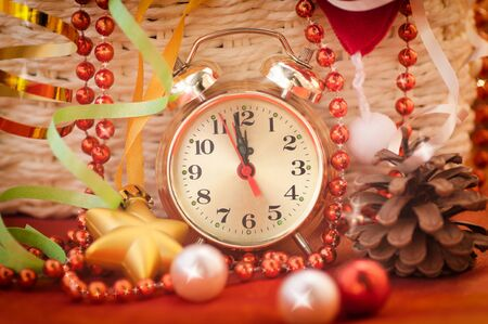 12 days of christmas: watch hands by 12 hours and Christmas toys background closeup Stock Photo