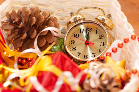 12 days of christmas: basket with Christmas toys and clock hands for 12 hours