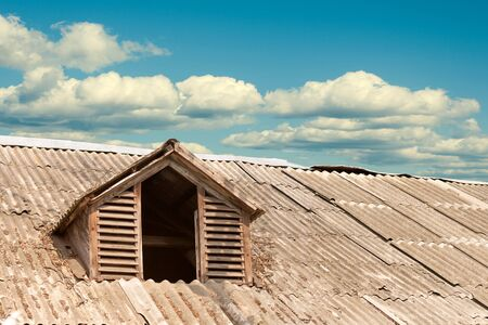 attic: attic window on the roof of the old Stock Photo