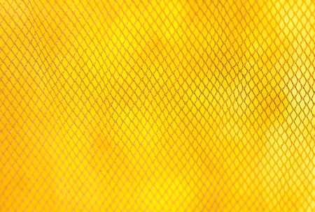 texture mesh mosquito net on a yellow background Stock Photo
