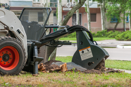 machine crushes the stump