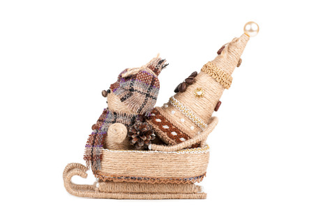 snowman with a Christmas tree sitting in a sleigh, isolated