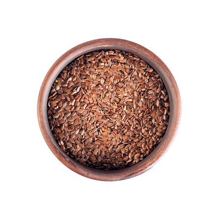 flax seeds, round ceramic cup, top view, isolated on white background