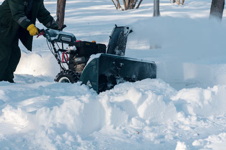 snow removal in the park Stock Photo