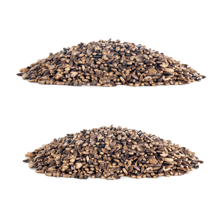 thistle seeds in a pile, set of two photos, isolated on white background Stock Photo