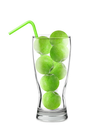 green apples in a glass, green cocktail tube, collage concept, isolated on white background