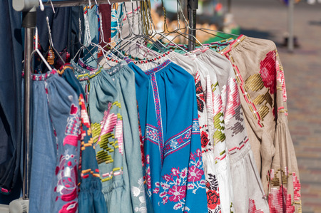 national Ukrainian clothes are sold at the fair, hanging on a hanger Фото со стока